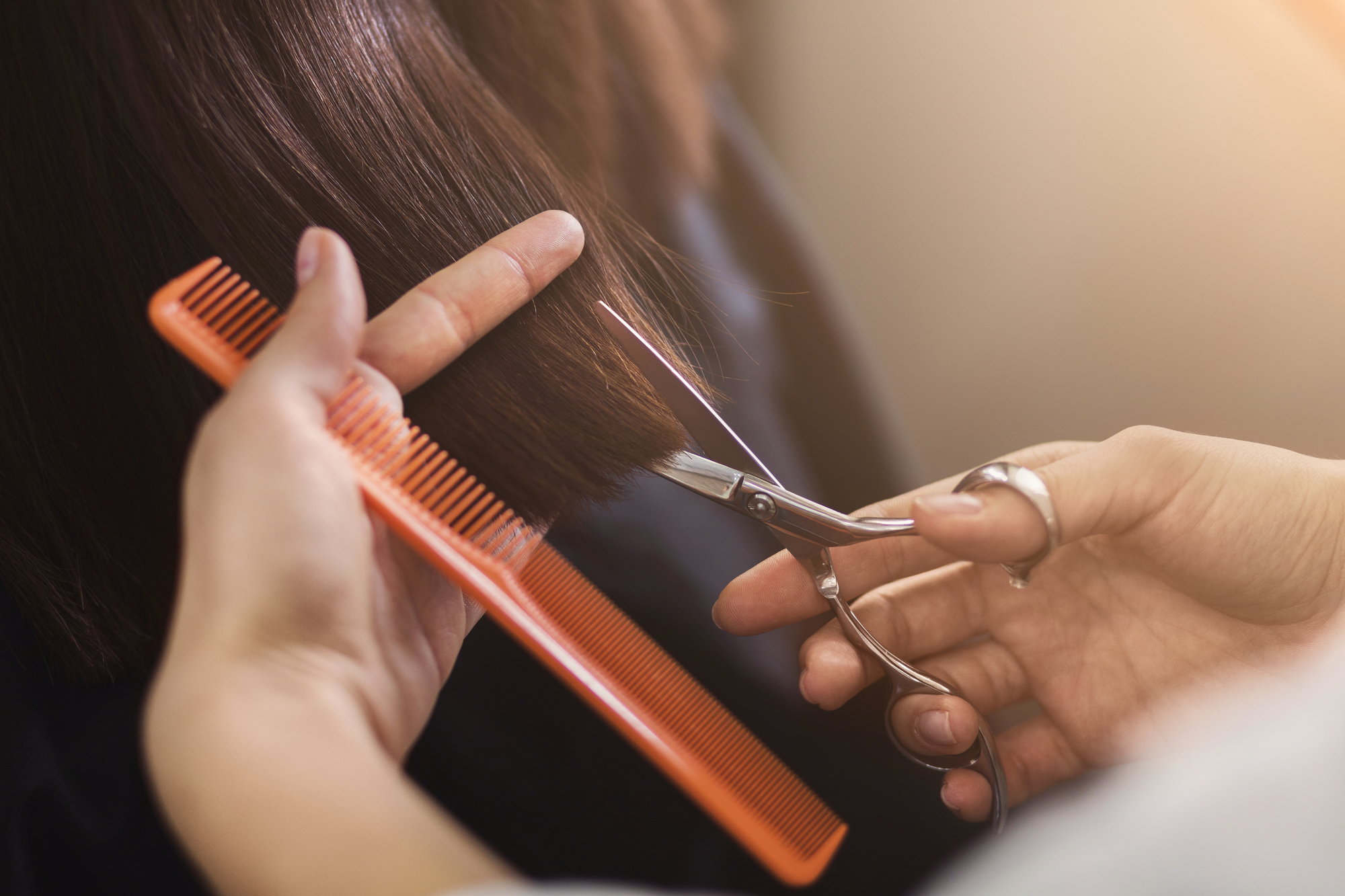 Cropped shot of a female client receiving a haircut at the local beauty salon. Healthy hair tips concept